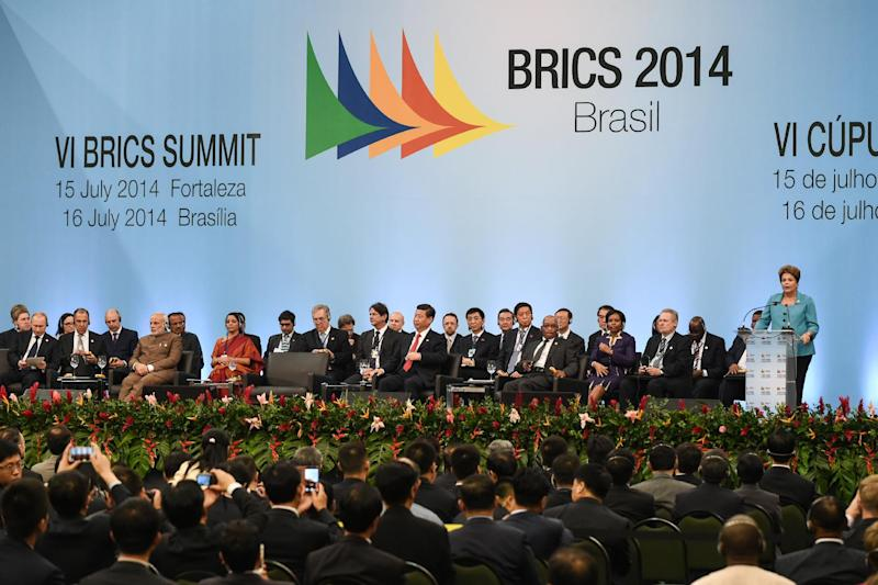 Brazilian President Dilma Rousseff (R) makes a speach during the 6th BRICS Summit in Fortaleza, Brazil, on July 15, 2014