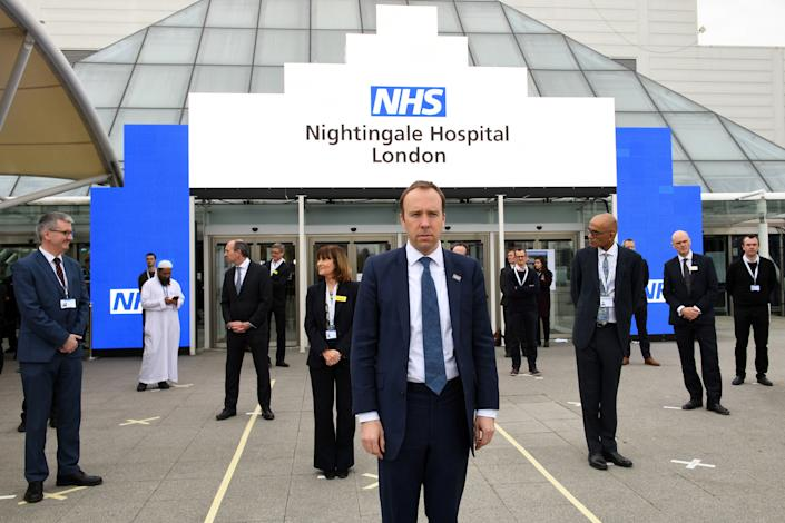 """Britain's Health Secretary Matt Hancock prepares for the opening of the """"NHS Nightingale"""" field hospital, created at the ExCeL London exhibition centre, in London on April 3, 2020, to help with the novel coronavirus COVID-19 pandemic. - The new state-run National Health Service (NHS) hospital, named after trailblazing 19th-century nurse Florence Nightingale, has been built in just nine days. (Photo by Stefan Rousseau / POOL / AFP) (Photo by STEFAN ROUSSEAU/POOL/AFP via Getty Images)"""