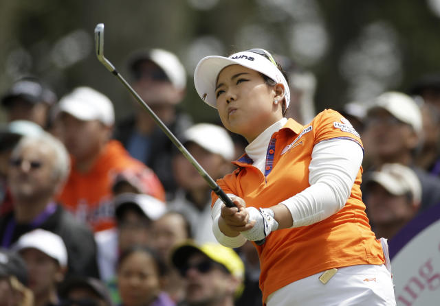 Jenny Shin follows her shot from the third tee of Lake Merced Golf Club during the final round of the Swinging Skirts LPGA Classic golf tournament on Sunday, April 27, 2014, in Daly City, Calif. (AP Photo/Eric Risberg)