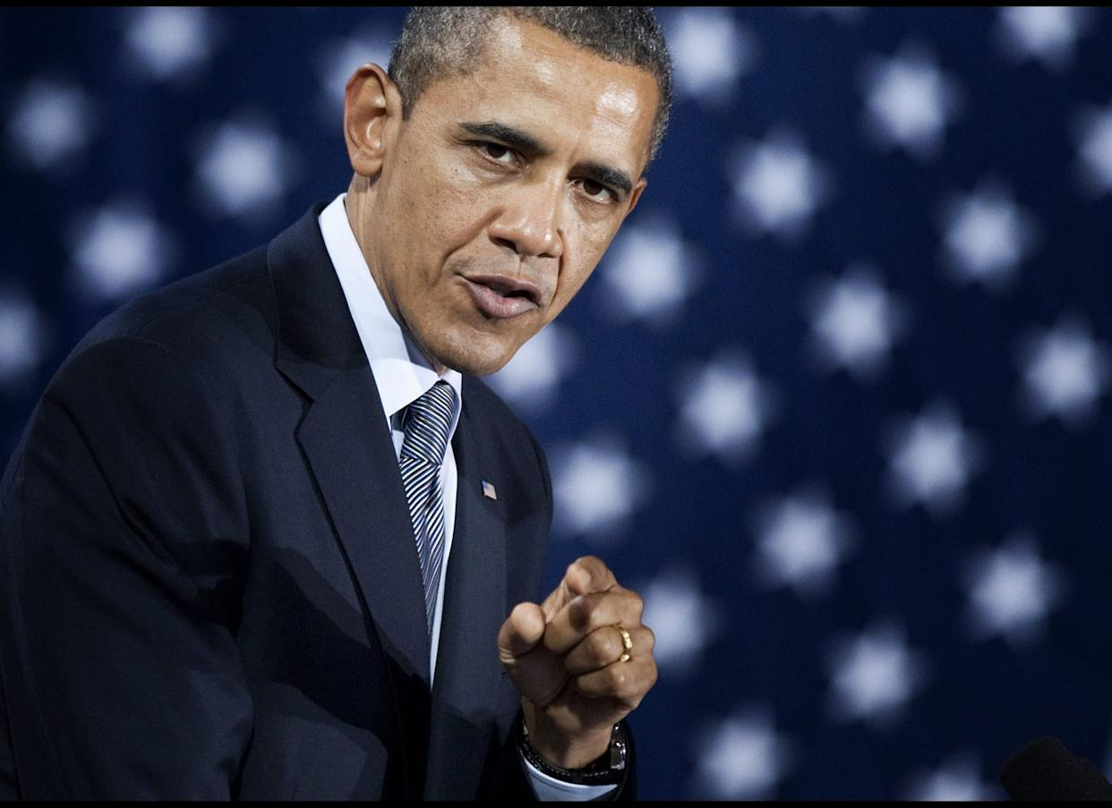 """On a campaign tour in the Midwest, Obama himself embraces the term """"Obamacare"""" and says the law shows """"I do care."""""""