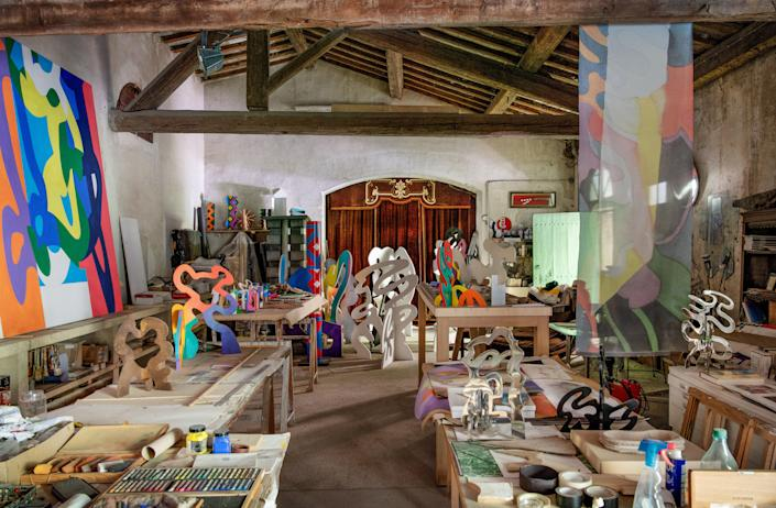 The artist's studio is filled with works in progress.