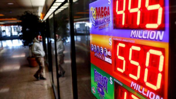 PHOTO: A sign advertises Powerball and Mega Millions lottery jackpots at a store in Atlanta, Jan. 4, 2018. (David Goldman/AP)
