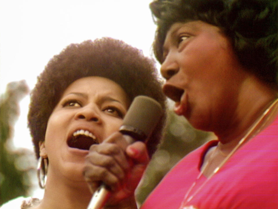 """This image released by Searchlight Pictures shows Mavis Staples, left, and Mahalia Jackson performing at the Harlem Cultural Festival in 1969, in a scene from the documentary """"Summer of Soul."""" (Searchlight Pictures via AP)"""