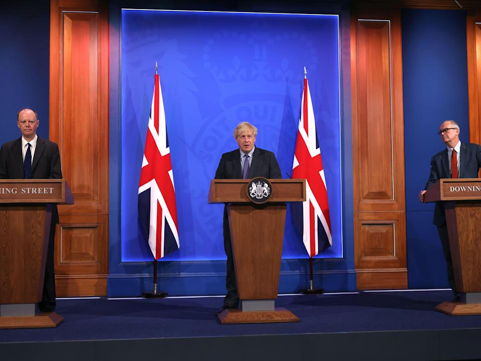 Chris Whitty (left), Boris Johnson (centre) and Sir Patrick Vallance (right) deliver a Covid update on 14 June (Getty)