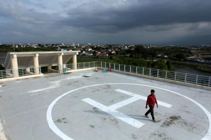Man walks on a helipad of Tsunami Escape Building in Banda Aceh