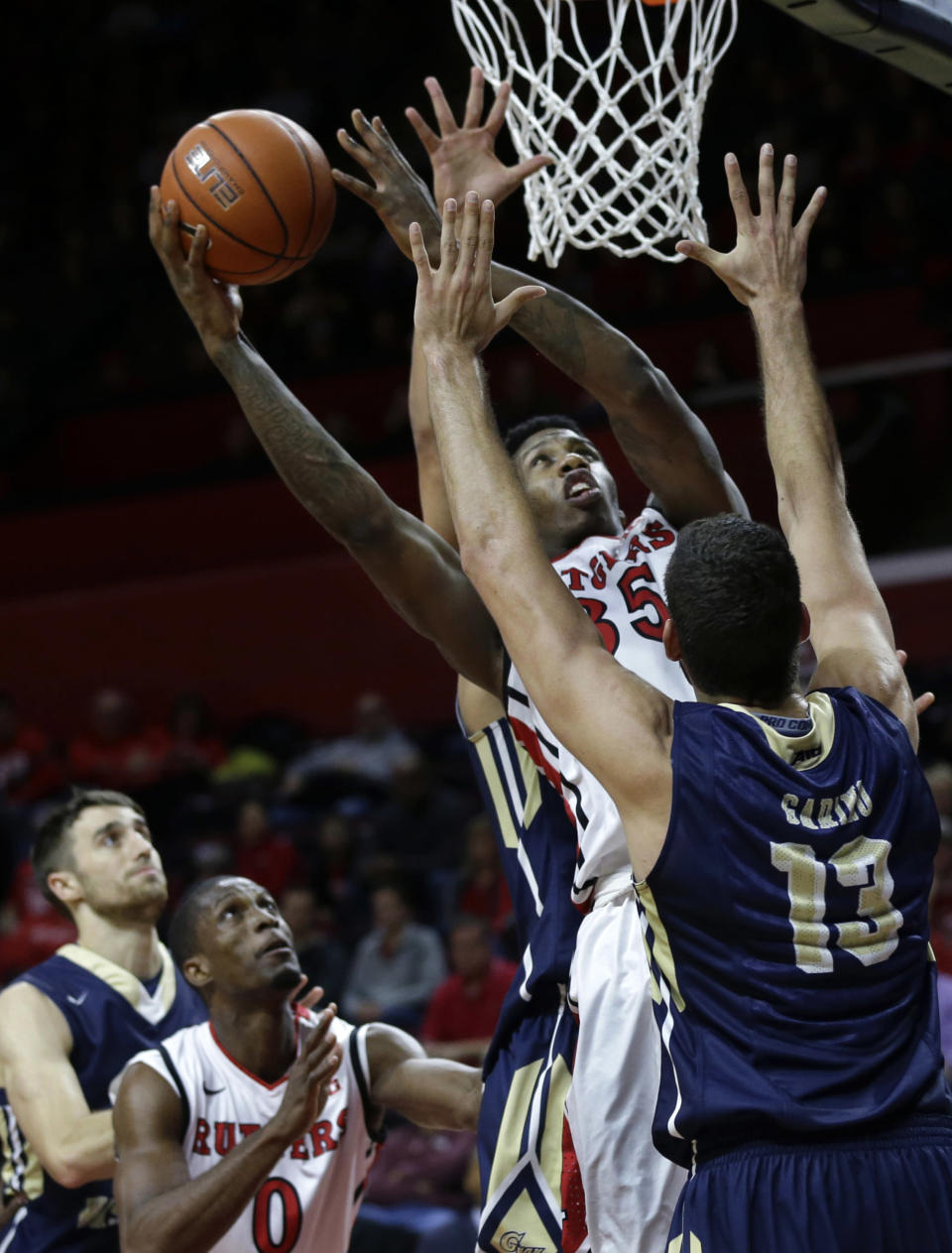 Rutgers' Greg Lewis (35) takes a shot past George Washington's Patricio Garino (13) during the first half of an NCAA college basketball game Sunday, Nov.16, 2014, in Piscataway, N.J. (AP Photo/Mel Evans)