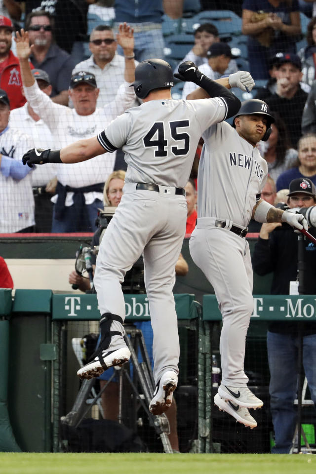 New York Yankees' Luke Voit, left, celebrates after his home run with Gleyber Torres during the first inning of a baseball game against the Los Angeles Angels in Anaheim, Calif., Tuesday, April 23, 2019. (AP Photo/Chris Carlson)