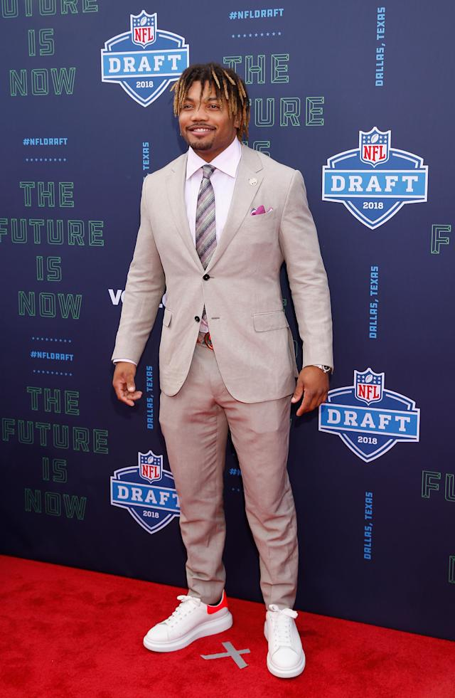 <p>Derrius Guice of LSU poses on the red carpet prior to the start of the 2018 NFL Draft at AT&T Stadium on April 26, 2018 in Arlington, Texas. (Photo by Tim Warner/Getty Images) </p>