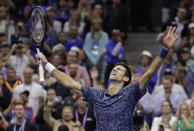 FILE - Novak Djokovic, of Serbia, celebrates after defeating Juan Martin del Potro, of Argentina, in the men's final of the U.S. Open tennis tournament in New York, in this Sunday, Sept. 9, 2018, file photo. Djokovic's pursuit of tennis history -- the first calendar-year Grand Slam by a man in more than a half-century and a men's-record 21st major title -- means all eyes will be on him when he is on the court at the U.S. Open. (AP Photo/Julio Cortez, File)