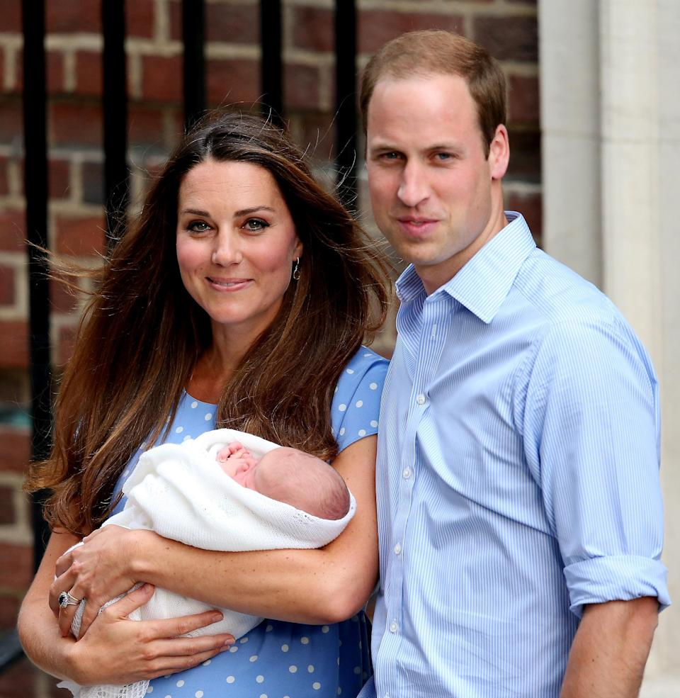 <p>Kate looked absolutely glowing with happiness to be holding her newborn son Prince George.</p>