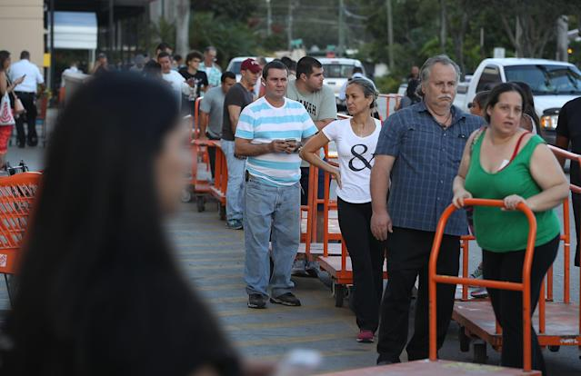 <p>People wait in line to purchase plywood at The Home Depot as they prepare for Hurricane Irma on September 6, 2017 in Miami, Fla. (Photo: Joe Raedle/Getty Images) </p>