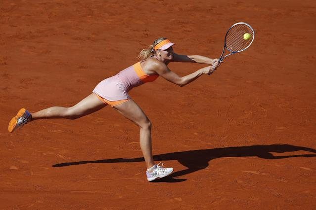 Russia's Maria Sharapova returns the ball during final of the French Open tennis tournament against Romania's Simona Halep at the Roland Garros stadium, in Paris, France, Saturday, June 7, 2014. (AP Photo/David Vincent)