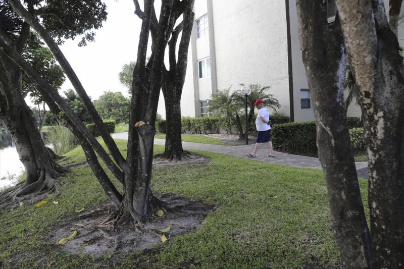 Mark Rousseau walks along the path where a couple claim a bobcat attacked them Friday, Oct. 4, 2019, in Fort Lauderdale, Fla. The woman was hospitalized with serious wounds and her husband was also treated for injuries. Florida wildlife officials say attacks by bobcats on humans are rare and wildlife experts say it usually happens when the animal is rabid or otherwise sick. (Amy Beth Bennett/South Florida Sun-Sentinel via AP)