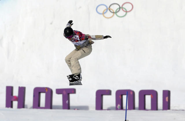 Lindsey Jacobellis of the United States takes a jump in her seeding run during women's snowboard cross competition at the Rosa Khutor Extreme Park, at the 2014 Winter Olympics, Sunday, Feb. 16, 2014, in Krasnaya Polyana, Russia. (AP Photo/Andy Wong)