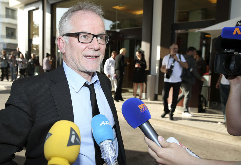 Cannes film festival director Thierry Fremaux speaks to journalists as he arrives at a hotel ahead of the 67th international film festival, Cannes, southern France, Tuesday, May 13, 2014. The festival runs from May 14th to May 25th. (AP Photo/Alastair Grant)