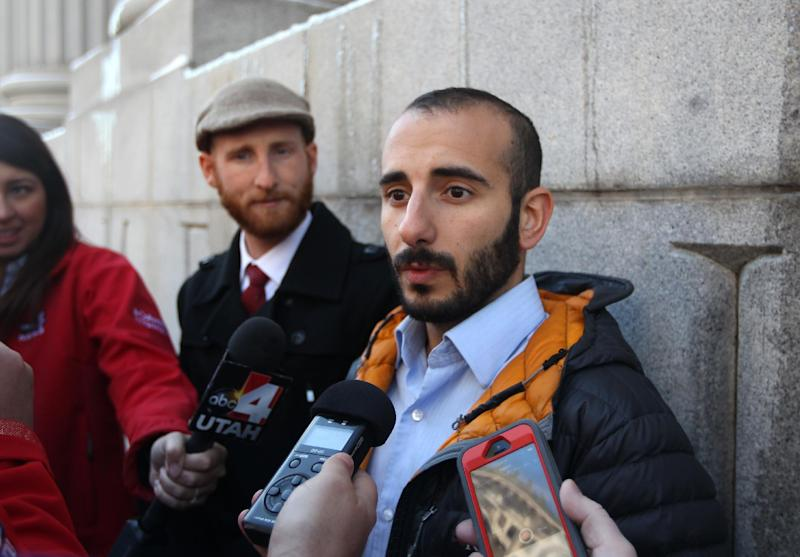 Derek Kitchen, left, and his partner Moudi Sbeity, right, talk with the media outside Frank E. Moss United States Courthouse following court on Wednesday, Dec. 4, 2013, in Salt Lake City. A challenge to Utah's same-sex marriage ban by three gay couples was back in court Wednesday as a federal court judge heard arguments in a case. Kitchen and Sbeity are plaintiff's in this case. (AP Photo/Rick Bowmer)