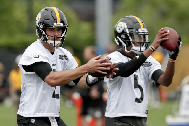 Pittsburgh Steelers quarterbacks Mason Rudolph, left, and Joshua Dobbs, right, drop back to pass during an NFL football practice, Thursday, May 30, 2019, in Pittsburgh. (AP Photo/Keith Srakocic)
