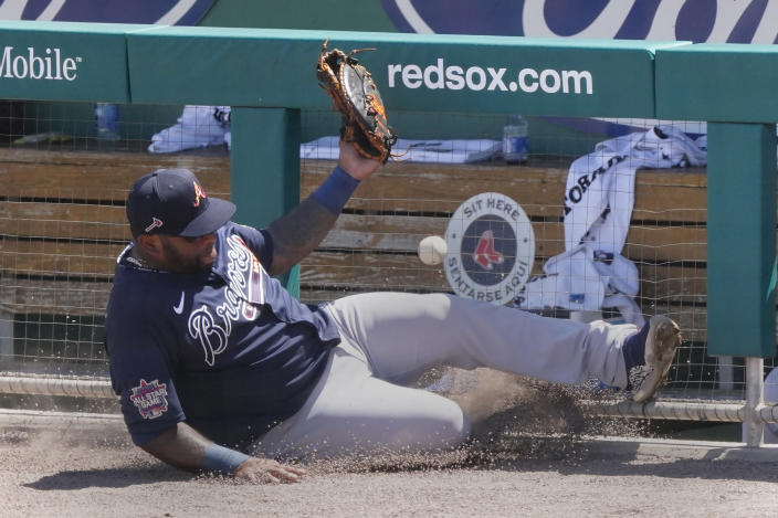 Atlanta Braves first baseman Pablo Sandoval (48) makes a sliding attempt for a foul ball hit by Boston Red Sox' Marwin Gonzalez in the fourth inning of a spring training baseball game Tuesday, March 30, 2021, in Fort Myers, Fla. (AP Photo/John Bazemore)
