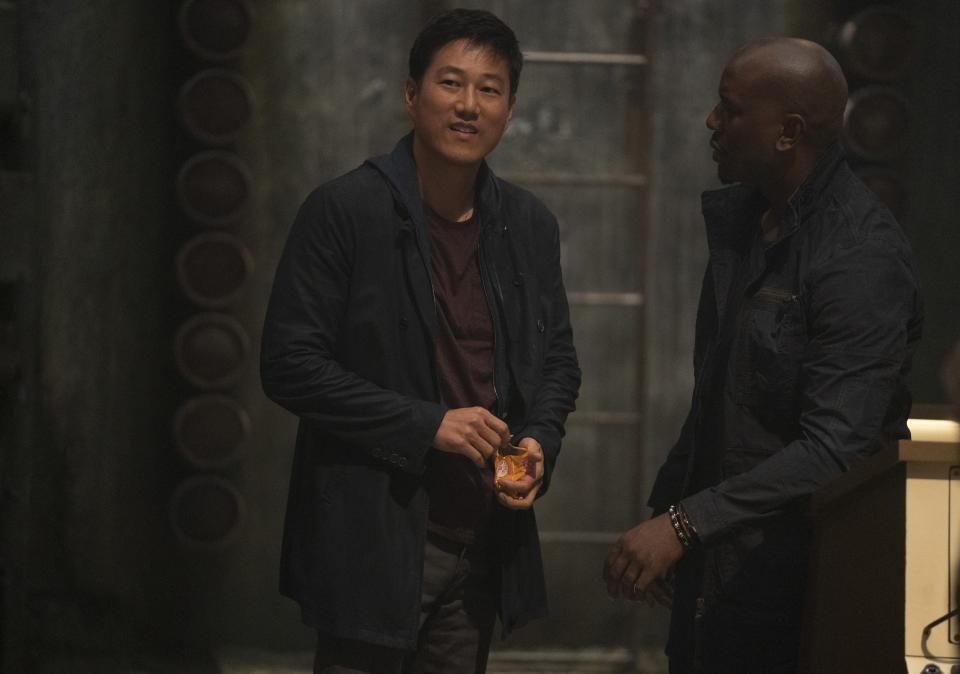 Han (Sung Kang) and Roman (Tyrese Gibson) in Fast & Furious 9 (Universal/PA)