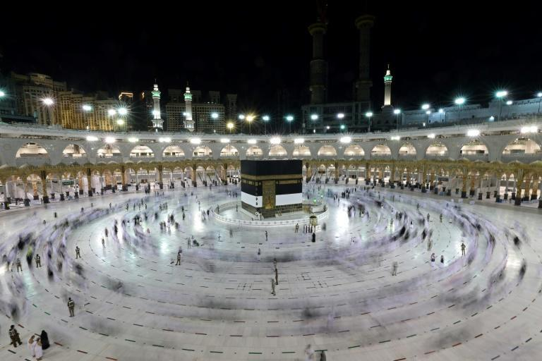 """Groups of pilgrims have been performing the """"tawaf"""" at Mecca's Grand Mosque, circling the Kaaba"""