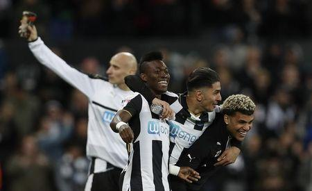 Britain Football Soccer - Newcastle United v Preston North End - Sky Bet Championship - St James' Park - 24/4/17 Newcastle's Christian Atsu celebrates being promoted to the premier league with Ayoze Perez and DeAndre Yedlin Action Images via Reuters / Lee Smith Livepic