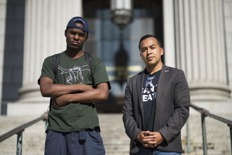 Attorney Cesar Vargas, right, the first openly undocumented attorney in New York, with his client Ivan Ruiz in Manhattan. (DAMON DAHLEN/HuffPost)