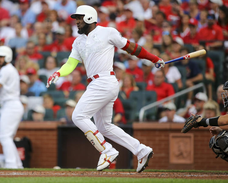 St. Louis Cardinals' Marcell Ozuna watches his two-run single during the first inning of the team's baseball game against the Colorado Rockies on Saturday, Aug. 24, 2019, in St. Louis. (AP Photo/Scott Kane)