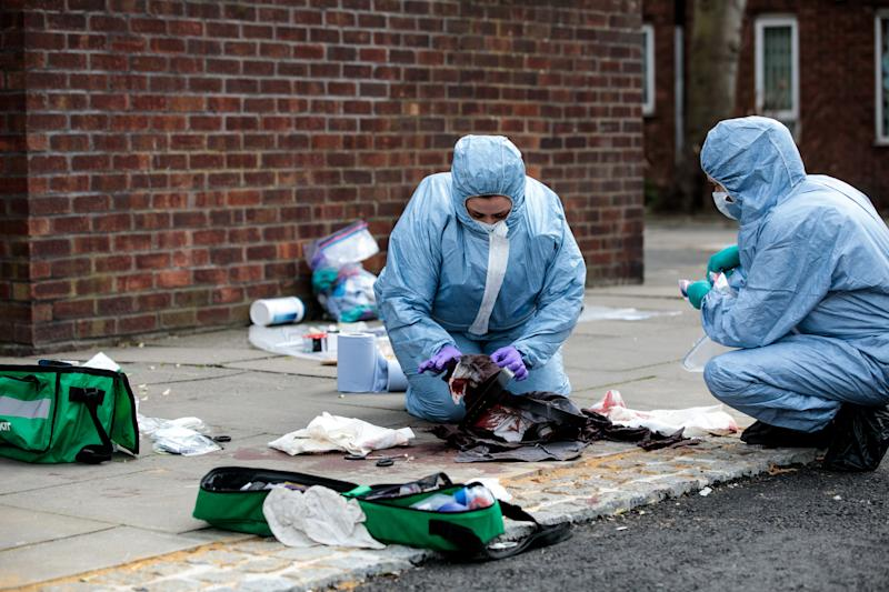 Forensics teams work at the scene of a stabbing in Edmonton, north London earlier this year (Photo by Jack Taylor/Getty Images)
