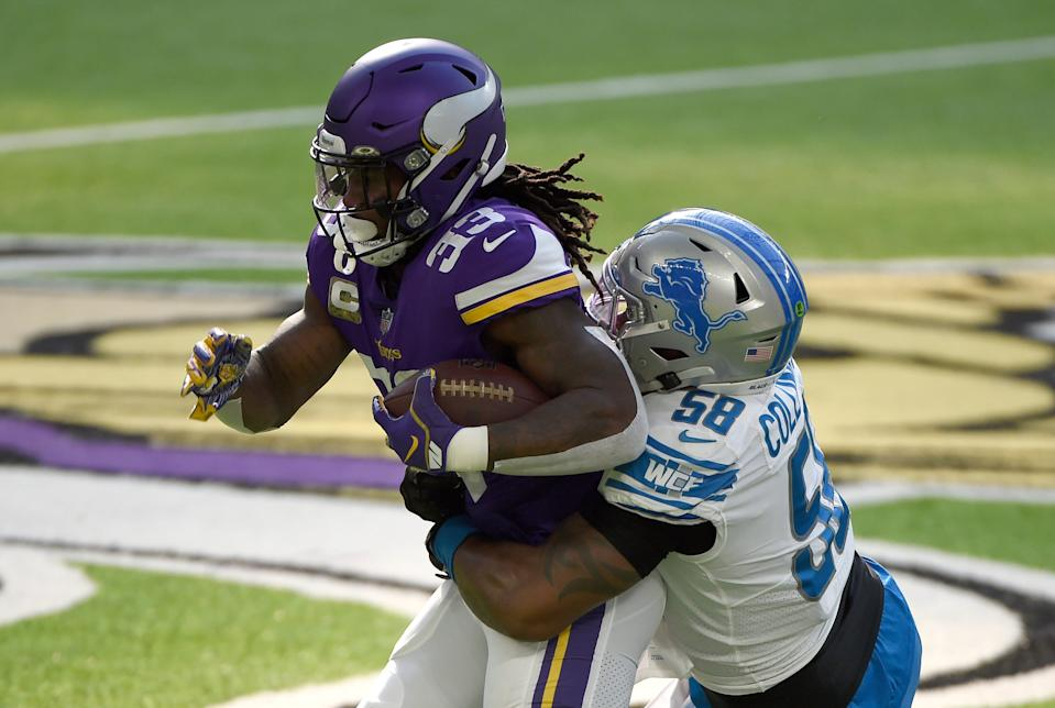 Dalvin Cook of the Minnesota Vikings is tackled by Jamie Collins Sr. of the Detroit Lions at U.S. Bank Stadium on Nov. 8, 2020 in Minneapolis, Minnesota.