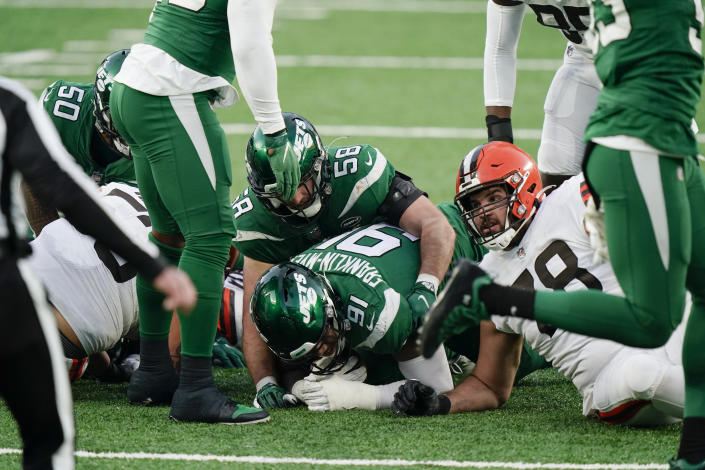Cleveland Browns offensive tackle Jack Conklin (78) reacts as New York Jets defensive end John Franklin-Myers (91) recovers a fumble during the second half of an NFL football game Sunday, Dec. 27, 2020, in East Rutherford, N.J. (AP Photo/Corey Sipkin)
