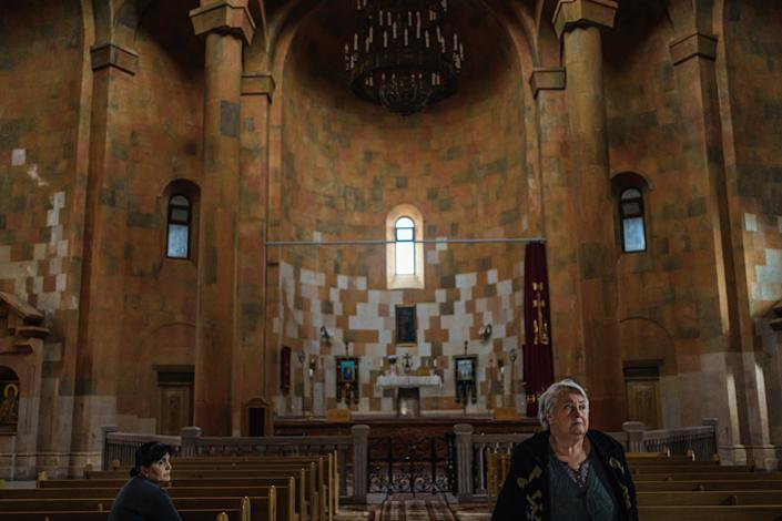 Two women visit a vintage cathedral in Stepanakert, Nagorno-Karabakh.