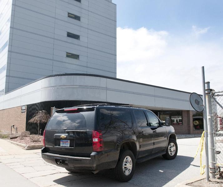A member of the FBI arrives on scene to investigate a suspicious letter that arrived at U.S. Sen. Carl Levin's Saginaw office in the Wickes Building, 515 N. Washington in Saginaw on Wednesday April 17, 2013. The incident comes a day after officials said a letter sent to Sen. Roger Wicker in Washington tested positive for poisonous ricin. (AP Photo/The Saginaw News,Jeff Schrier ) ALL LOCAL TV OUT; LOCAL TV INTERNET OUT