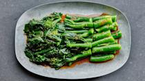 """Steamed Chinese broccoli just needs a bit of umami-rich soy paste to truly shine. Serve with rice and <a href=""""https://www.epicurious.com/recipes/food/views/soy-braised-chicken-wings?mbid=synd_yahoo_rss"""" rel=""""nofollow noopener"""" target=""""_blank"""" data-ylk=""""slk:these luscious chicken wings"""" class=""""link rapid-noclick-resp"""">these luscious chicken wings</a>. <a href=""""https://www.epicurious.com/recipes/food/views/chinese-broccoli-with-soy-paste?mbid=synd_yahoo_rss"""" rel=""""nofollow noopener"""" target=""""_blank"""" data-ylk=""""slk:See recipe."""" class=""""link rapid-noclick-resp"""">See recipe.</a>"""
