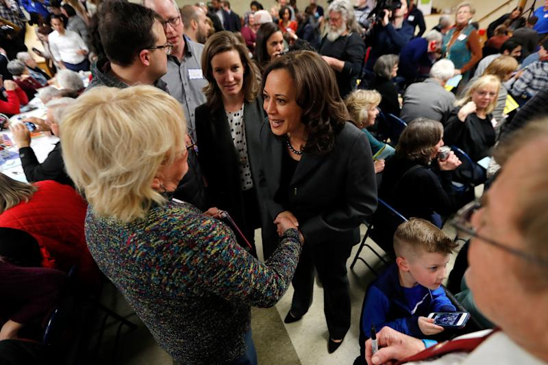 Democratic presidential candidate Sen. Kamala Harris greets local residents at the Story County Democrats' annual soup supper fundraiser, Saturday, Feb. 23, 2019, in Ames, Iowa. (AP Photo/Charlie Neibergall)