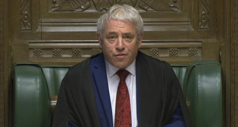 Speaker of the House of Commons John Bercow calls the house to order before Prime Minister Boris Johnson delivers a statement to lawmakers inside the House of Commons in London Saturday Oct. 19, 2019. At a rare weekend sitting of Parliament, Johnson implored legislators to ratify the Brexit deal he struck this week with the other 27 EU leaders. (House of Commons via AP)
