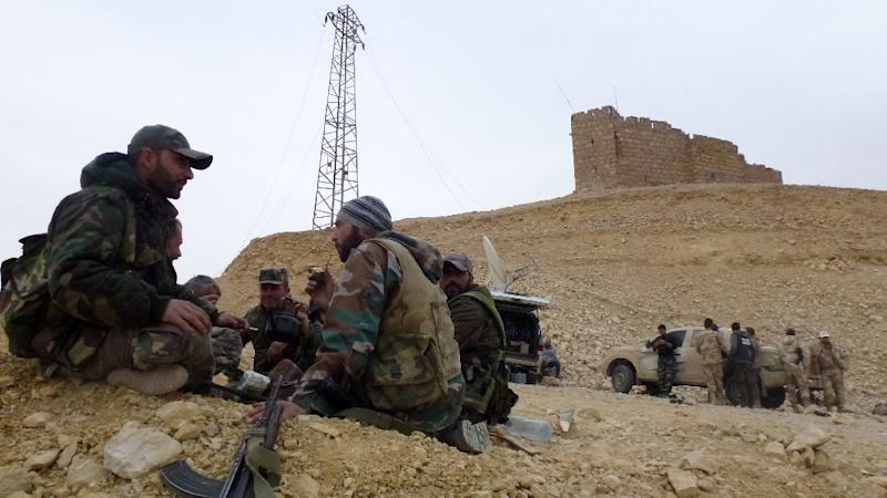 Syrian pro-government forces rest next to the Palmyra citadel (AFP Photo/Maher Al Mounes)