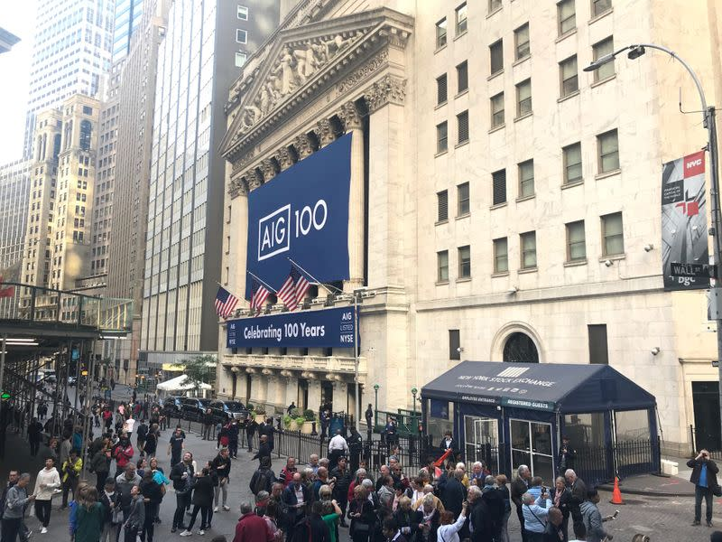FILE PHOTO: Banners commemorating the 100th anniversary of American International Group Inc. adorn the New York Stock Exchange