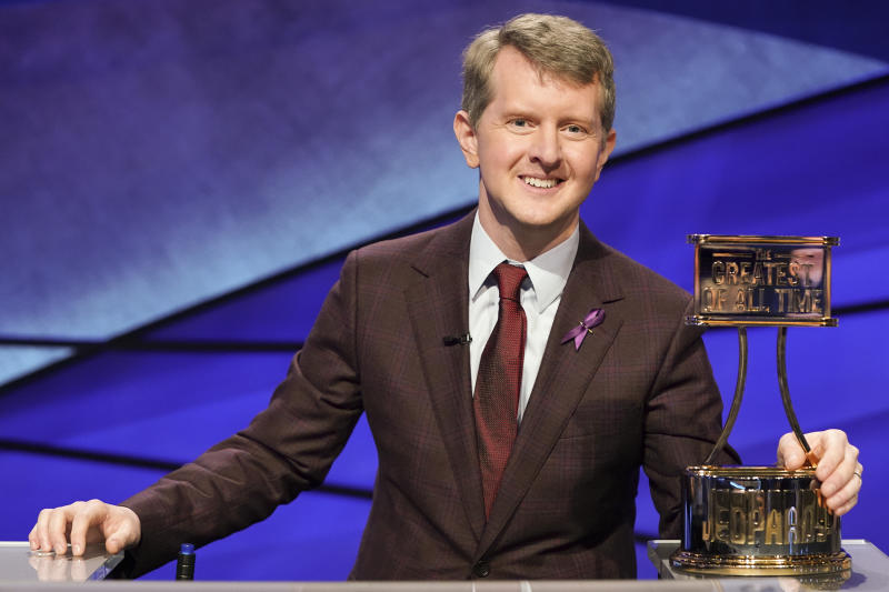 "This image released by ABS shows contestant Ken Jennings with a trophy on ""JEOPARDY! The Greatest of All Time."" Jennings, the veteran who beat young hotshot James Holzhauer and Brad Rutter, won the $1 million prize in the tournament that stretched out over four entertaining nights on ABC's prime-time schedule. (Eric McCandless/ABC via AP)"