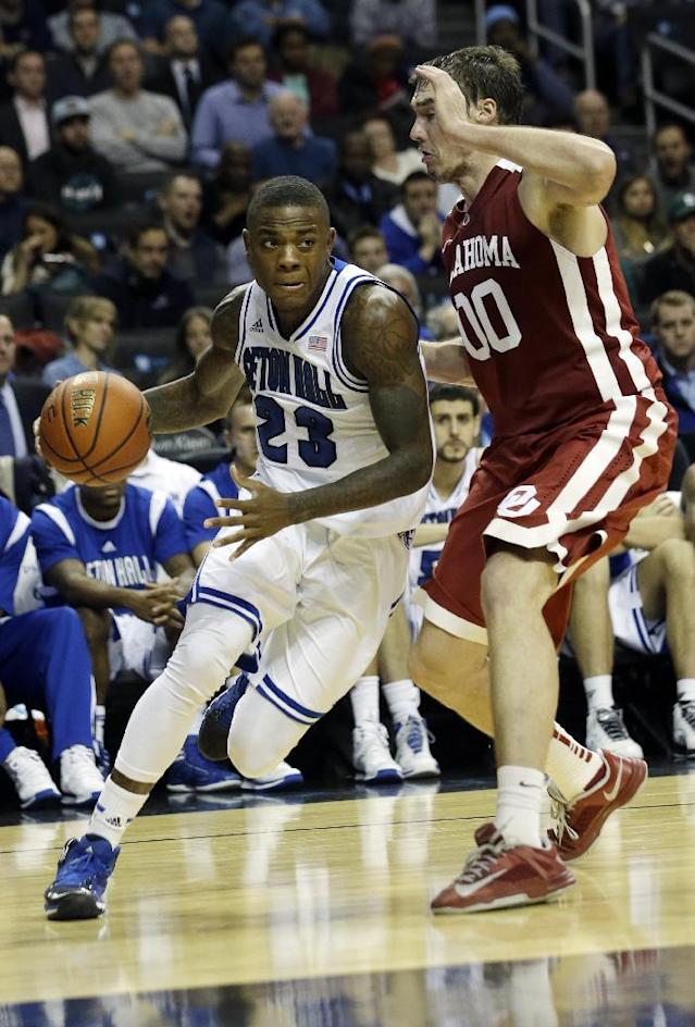 Seton Hall Fuquan Edwin (23) is defended by Oklahoma's Ryan Spangler during the second half of a Coaches vs. Cancer NCAA college basketball game Friday, Nov. 22, 2013, in New York. Oklahoma won 86-85. (AP Photo/Frank Franklin II)