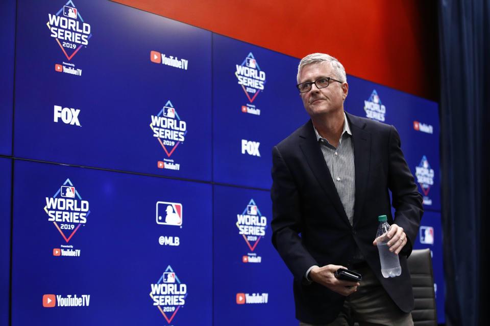 Houston Astros general manager Jeff Luhnow departs after speaking during a news conference Thursday, Oct. 24, 2019, in Washington. The Astros and the Washington Nationals are scheduled to play Game 3 of baseball's World Series on Friday. (AP Photo/Patrick Semansky)
