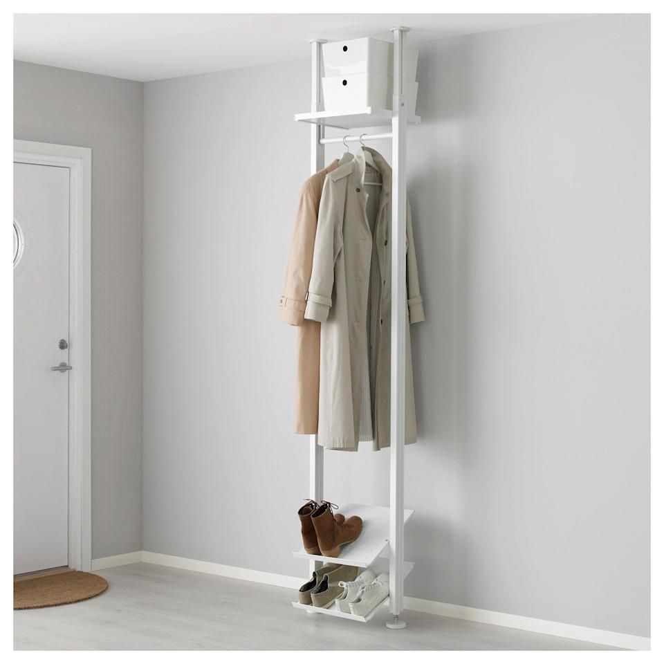 <p>The <span>Elvarli Shelf Unit</span> ($100) makes storing your go-to belongings a breeze with its tilted shelves and convenient clothing rack.</p>