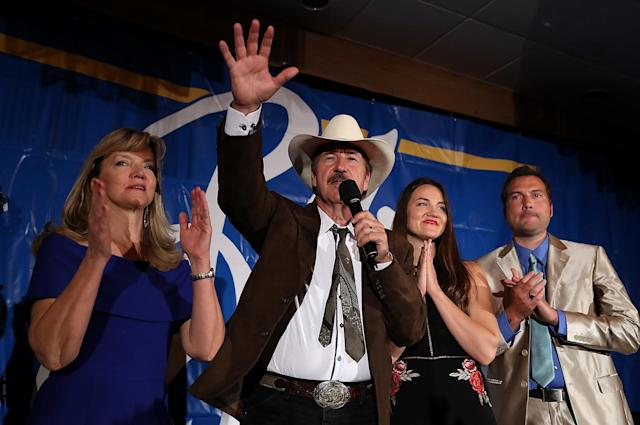 Democratic Congressional candidate Rob Quist delivers his concession speech to supporters alongside family members on May 25 in Missoula, Mont. (Photo: Justin Sullivan/Getty Images)