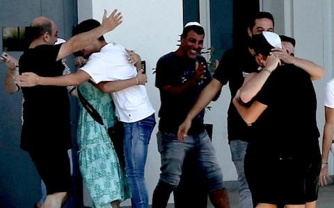 <span>An Israeli teenager is embraced by relatives after being released from Famagusta police headquarters in southeast town of Paralimni, Cyprus,</span> <span>Credit: AP </span>