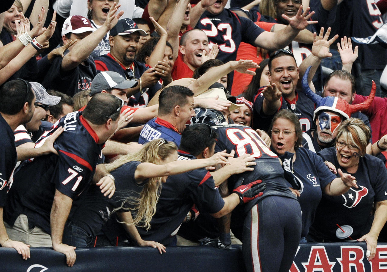 Houston Texans wide receiver Andre Johnson (80) dives into the crowd after scoring the winning touchdown against the Jacksonville Jaguars in overtime of an NFL football game, Sunday, Nov. 18, 2012, in Houston. The Texans won 43-37. (AP Photo/Dave Einsel)