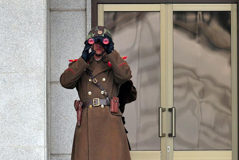 A North Korean soldier trains his sights on the South at the truce village of Panmunjom in the Demilitarised Zone dividing the two Koreas in 2014 (AFP Photo/Jung Yeon-Je)