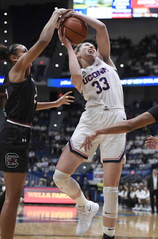Connecticut's Katie Lou Samuelson, right, is fouled by South Carolina's Mikiah Herbert Harrigan, left, during the first half of an NCAA college basketball game, Monday, Feb. 11, 2019, in Hartford, Conn. (AP Photo/Jessica Hill)