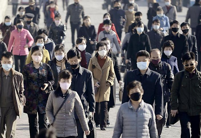 Commuters wearing face masks in Pyongyang, North Korea, on March 30. (Kyodo via Reuters)