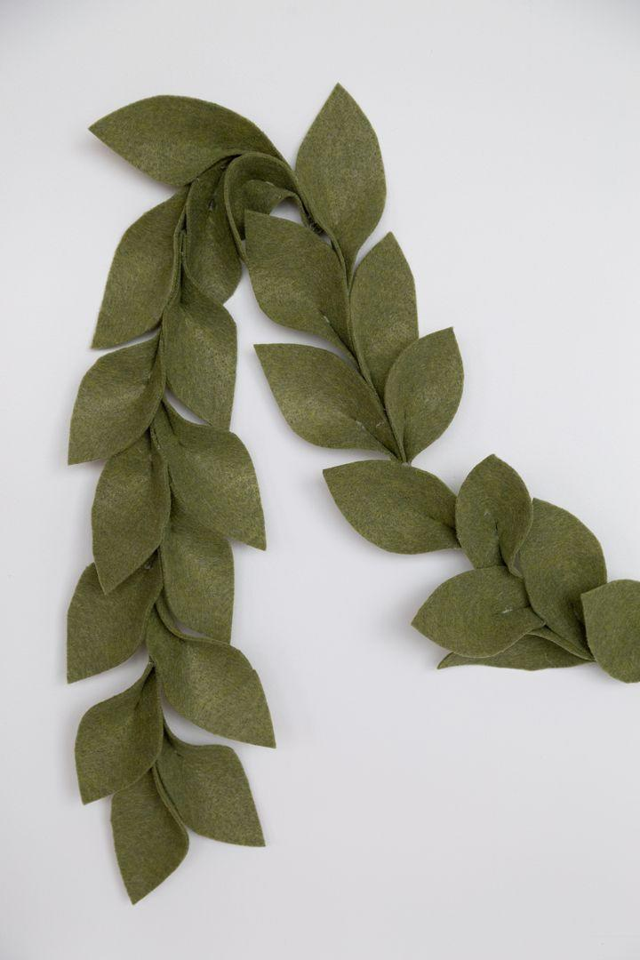 """<p>Greenery is always a nice touch, but it has a finite lifespan. If you love the look, but prefer something that will last from year to year, try this felt version. </p><p><a href=""""https://www.aliceandlois.com/diy-holiday-felt-garland/"""" rel=""""nofollow noopener"""" target=""""_blank"""" data-ylk=""""slk:Get the tutorial."""" class=""""link rapid-noclick-resp"""">Get the tutorial.</a></p><p><a class=""""link rapid-noclick-resp"""" href=""""https://www.amazon.com/Barcelonetta-Acrylic-Fabric-Cushion-Padding/dp/B08W8JNNJR/?tag=syn-yahoo-20&ascsubtag=%5Bartid%7C10072.g.37499128%5Bsrc%7Cyahoo-us"""" rel=""""nofollow noopener"""" target=""""_blank"""" data-ylk=""""slk:SHOP FELT"""">SHOP FELT</a></p>"""