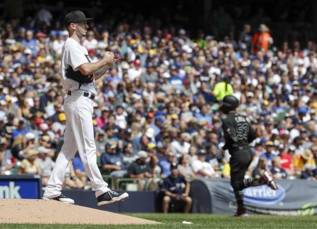 Milwaukee Brewers starting pitcher Zach Davies rests after giving up a two-run home run to Arizona Diamondbacks' Christian Walker during the first inning of a baseball game Sunday, Aug. 25, 2019, in Milwaukee. (AP Photo/Morry Gash)