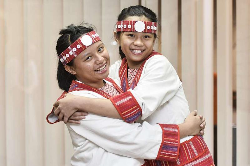 It's up to indigenous children like Xiao Yun (left) and Xiao Lin to preserve their culture for the next generation.